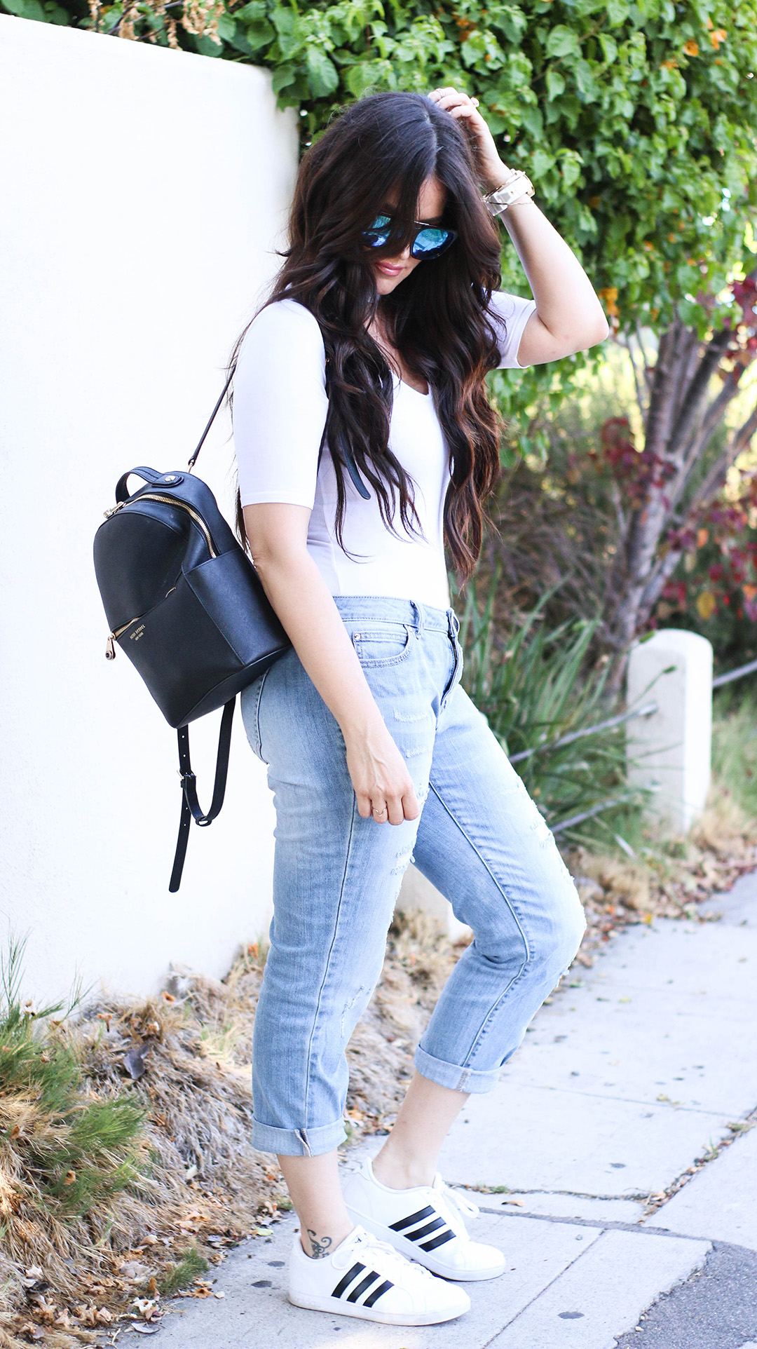 white body suit and boyfriend jeans